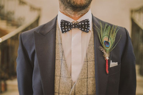 Peacock feather boutonniere | Via Love My Dress