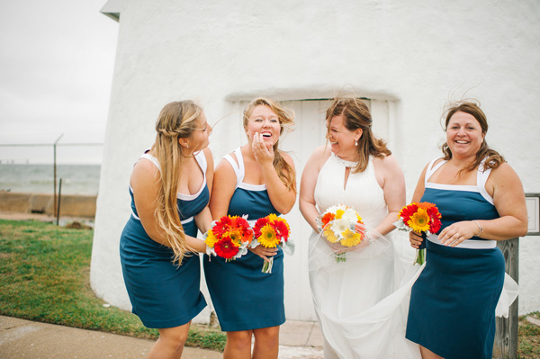 The bride's dress has a high neckline. Real SoMd Wedding: Personal Style at Cove Point Lighthouse