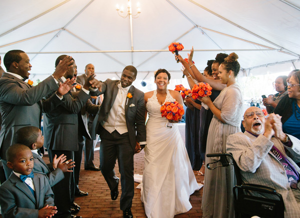 The bride is wearing a halter neckline. Real SoMd Wedding: Orange and Blue Accents — and the Cutest Flower Girl!